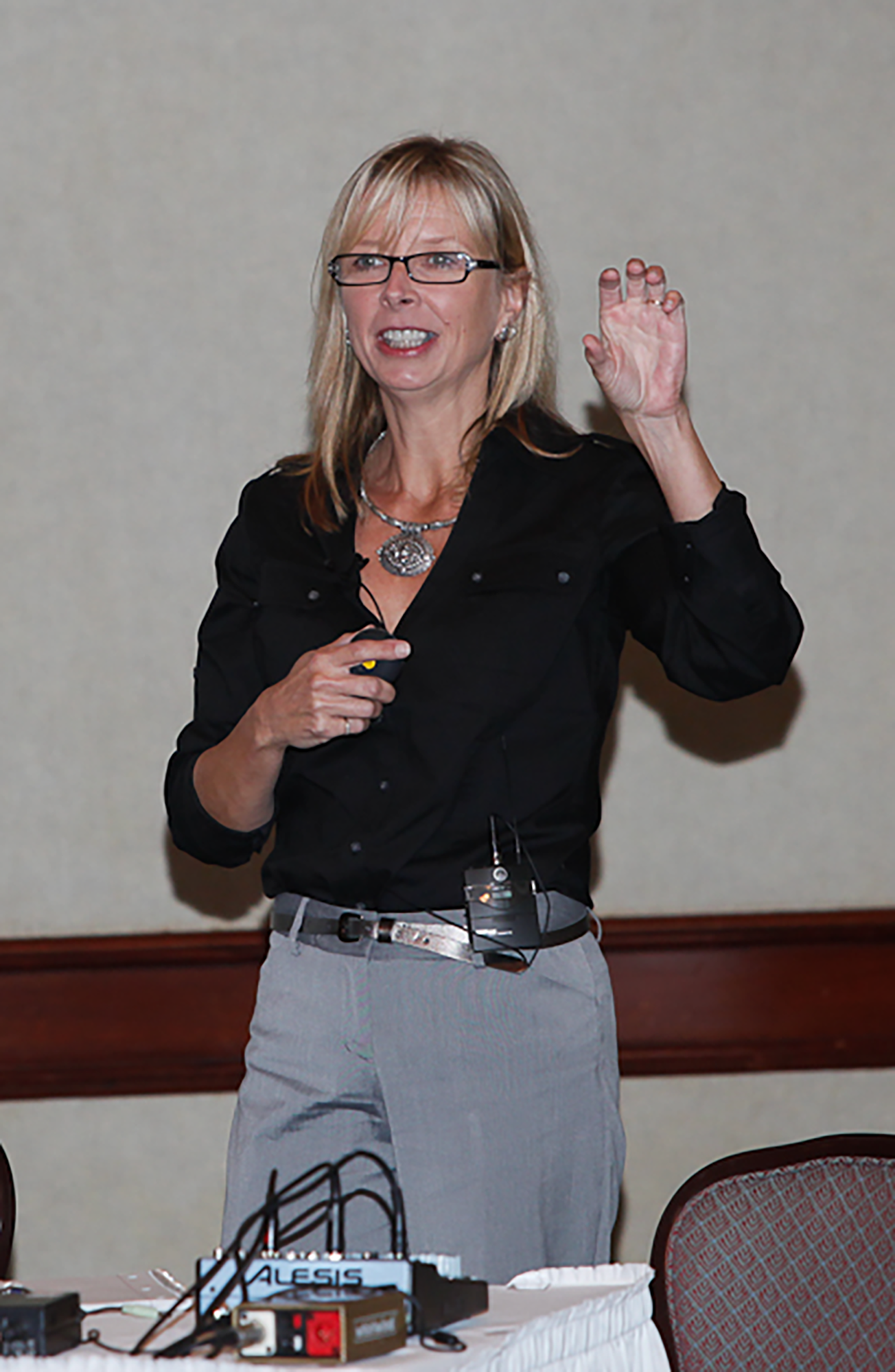 Julie gestures while teaching at the Presentation Summit